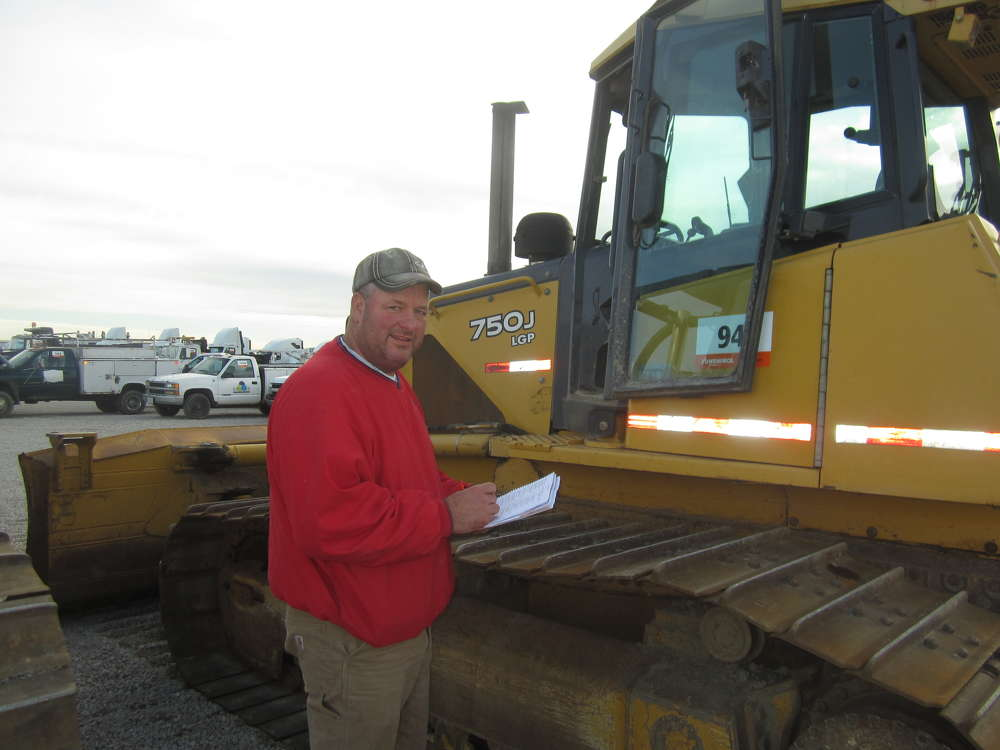 Mike Loecke of Loecke Auction Services takes note of this John Deere 750J.