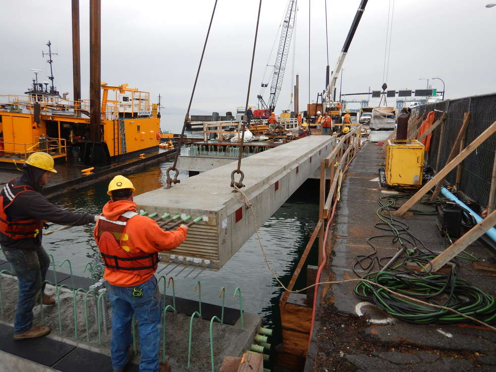 Quigg Bros.' crew is installing a precast girder in the section of the Vashon Terminal trestle that is being replaced.