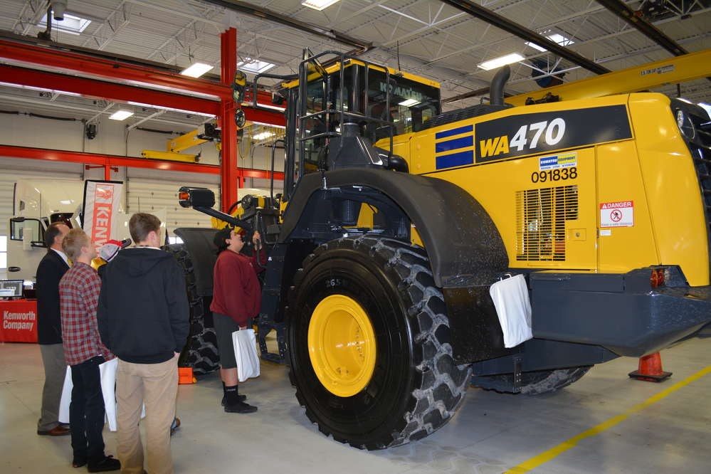 Students take a close-up look at a Komatsu loader before Gov. Herbert introduced Diesel Tech, a program to help students pursue a career in the diesel technology field.