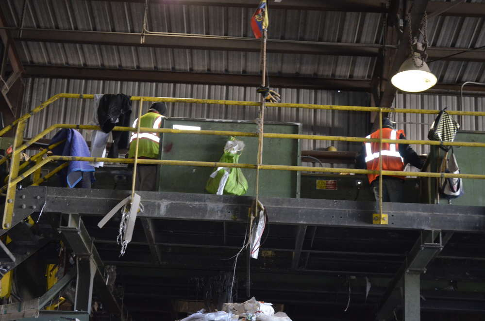 From the picking station, workers remove items by hand that are not recyclable.
