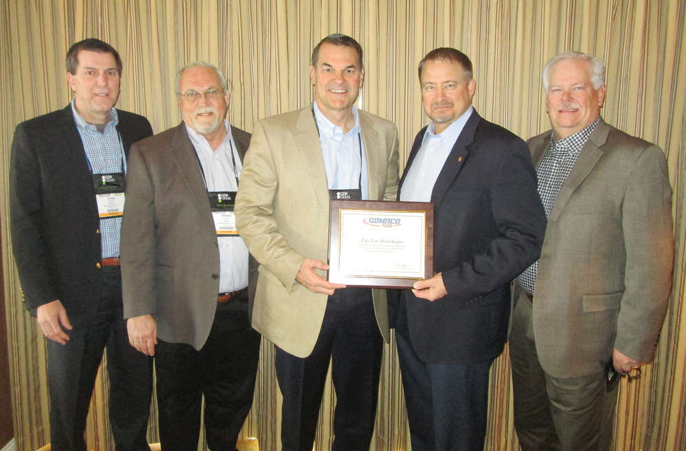 (L-R) are Craig Burkert, Charlie Clarkson and Robert Mullins, ROMCO Equipment Company; Kent Godbersen, GOMACO Vice president of worldwide sales and marketing; and David Fitch, ROMCO Equipment Company.