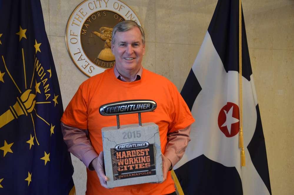 Indianapolis Mayor Greg Ballard with the Freightliner Trucks Hardest Working Cities Award.