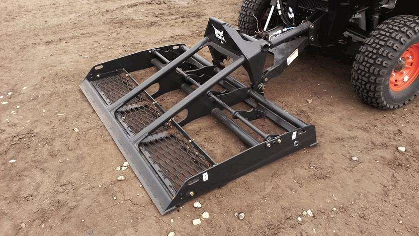 The bi-directional, site preparation and landscaping attachment allows operators to work in both forward or reverse to easily break up hard ground or level high points.