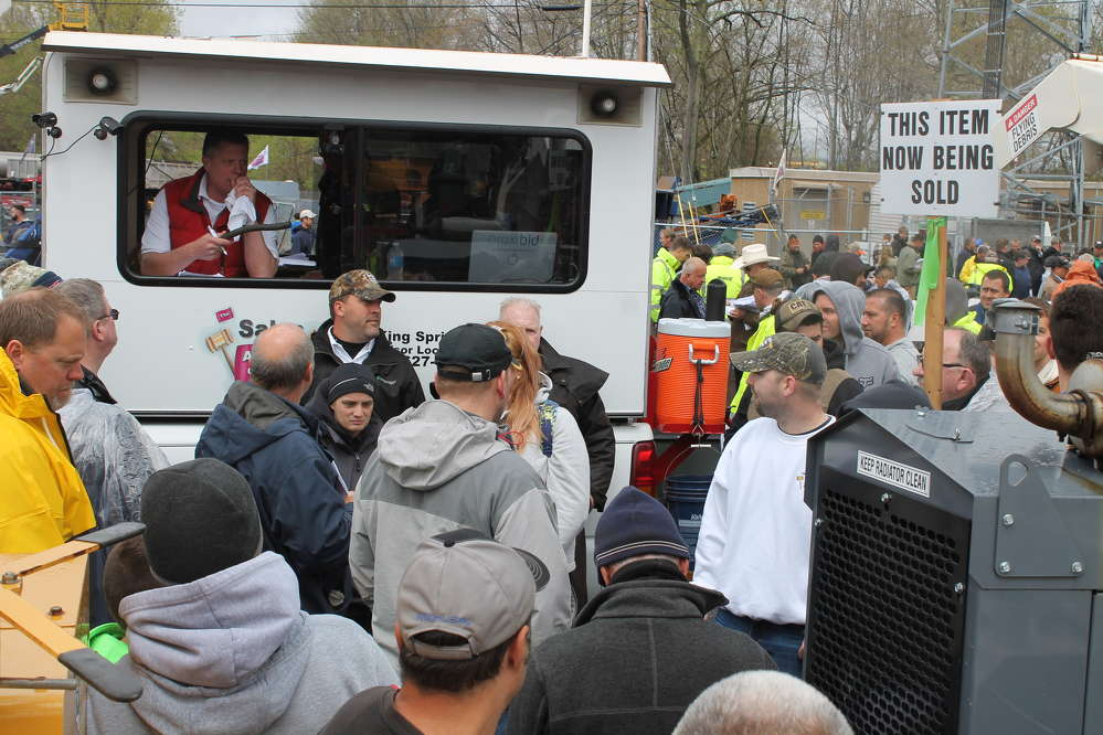 This mobile auction truck drives around the site leading the crowd to the items up for bid.