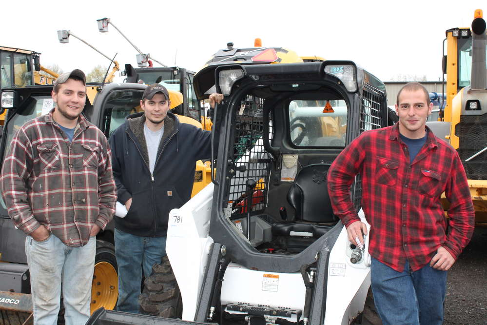 (L-R) are Joey Kratzke and David Godek, both of Barber Utilities, Ellington, Conn., and Jake Lipton of Pleasant View Farms, located in Somers, Conn.