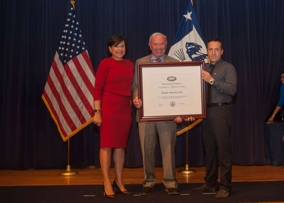 """Jerry Morey (C), Bandit president, along with Felipe Tamayo (R), international sales manager, were presented the President's """"E"""" Award for Export by Secretary of Commerce, Penny Pritzker."""