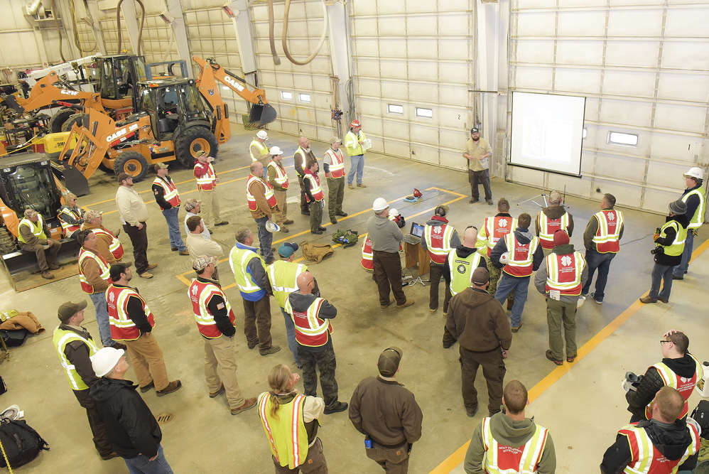 Team Rubicon members receive instruction at Titan Machinery's Shakopee, Minn., branch.