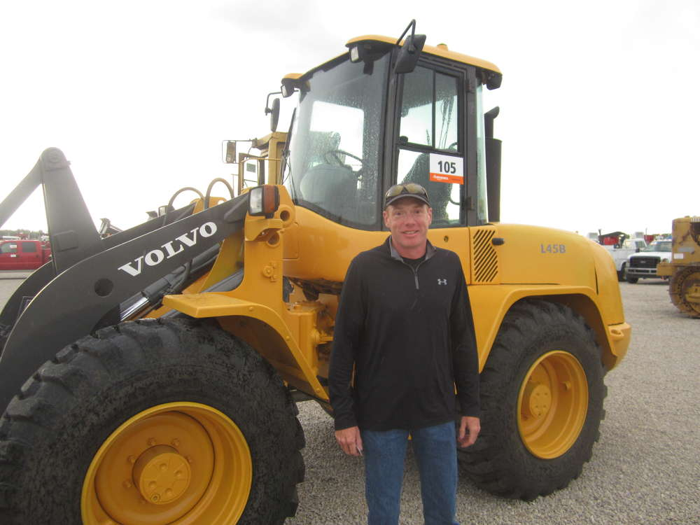Kent Elrod of Elrod Excavating stands in front of this Volvo L45B wheel loader.