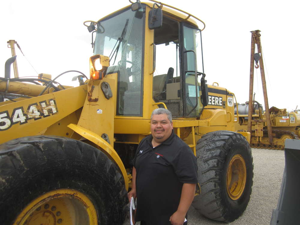 Fredy Quevedo of Valley Enterprises Inc. gets ready to run this John Deere 544 wheel loader.