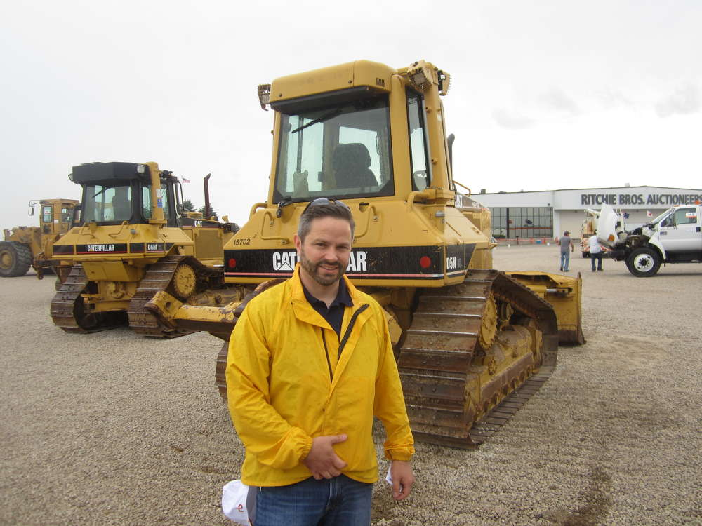 Ben Hafele, Hafele Construction, looks at the selection of dozers.