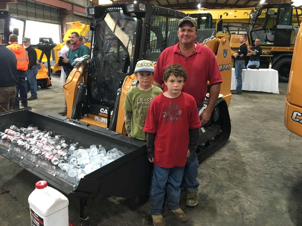 Clint McGraw, C&M Recycling in Charlotte, brings his sons,  Jesse and Owen to the event.