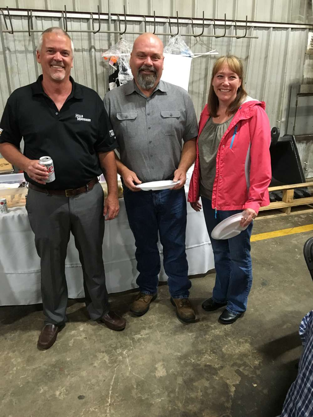 (L-R):Doug Spitzer, Hills Machinery, welcomes Billy Wray of Lane Construction in Charlotte and Lori Wray of Sugar Creek Construction.