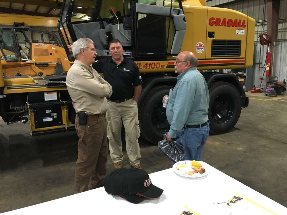 (L-R): Mark Allison of Gradall and Mike Mandagona of Hills Machinery go over the Gradall XL4100 IV with Rick Natali of North Star Demolition in Charlotte.