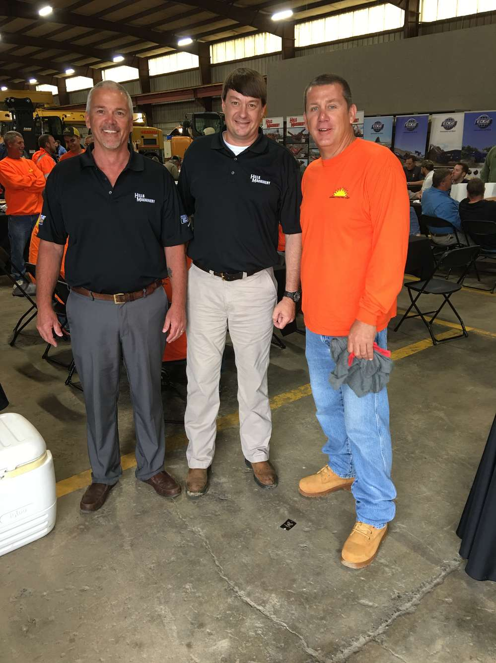 Doug Spitzer and Adam Hills, both of Hills Machinery, thank Rob Petrillo of Sunbelt Utilities for coming to the open house.