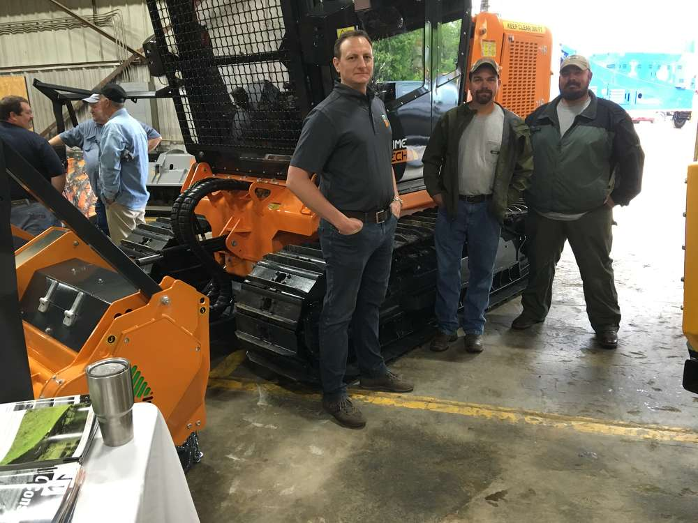 (L-R): Giorgio Carera, CEO of FAE USA Inc. in Flowery Branch, Ga., explains the features of  PrimeTech products to Tim Keller and Nick Shaver, both of NC Wildlife.