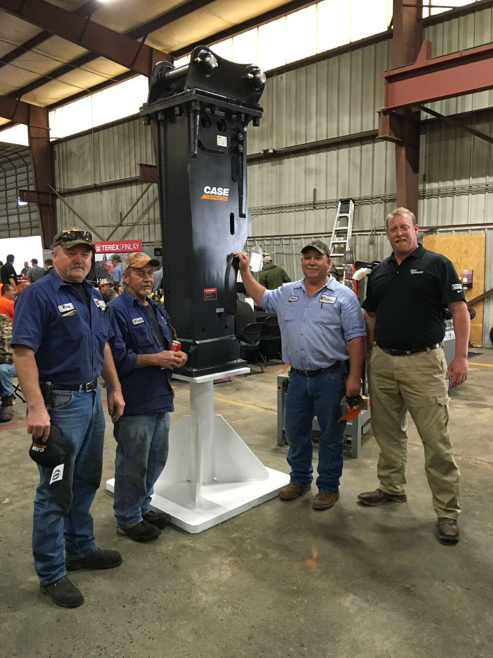Cameron Waugh (R) with Hills Machinery goes over the Case 5,000 lb. hammer with (L-R) Rickey Osborne, Frankie Pittman and Danny Biggers, all of Ferebee Corporation in Charlotte.