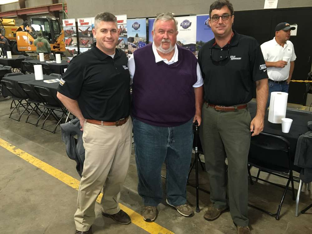 (L-R): Mike Kemmerer of Hills Machinery and Jim Hills, president of Hills Machinery, welcome Arden Reiser of Coastline Partners who is in the business of creek restoration, erosion control and more.