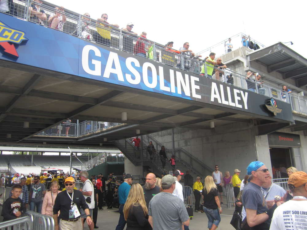 Customers walk around the world-renowned Gasoline Alley.