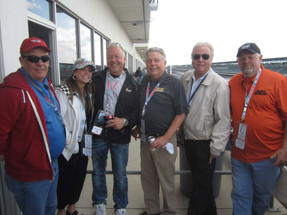 (L-R): Dave Prentice, Phoenix Services; Michelle Tosto and Mike Schwartz, Utility Services; Tom Ellis, president, Howell Tractor & Equipment LLC; Jack Lanigan, president of Lanco group of companies; and Gray Bowser, Phoenix Services, get ready for the Indy 500 time trails at the Mi-Jack suite.