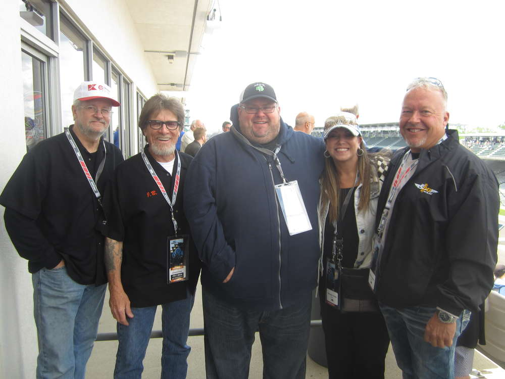 (L-R): Mike Abraham and Jim Bracken, both of Brackenbox; Mark Dehnert, Howell Tractor & Equipment LLC; and Michelle Tosto and Mike Schwartz, Utility Services, share a laugh before the race.