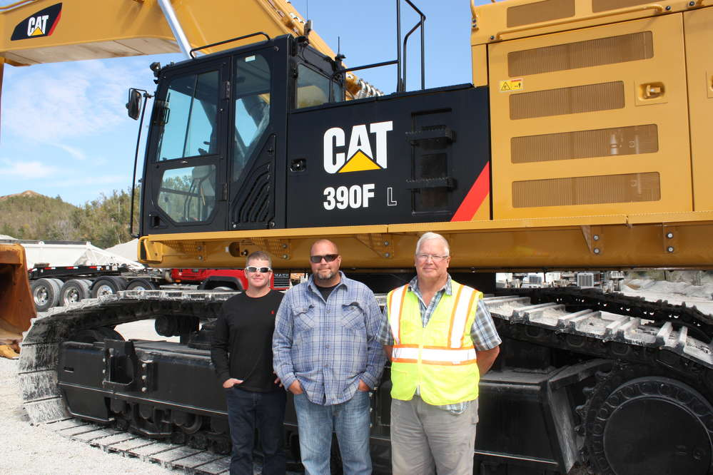 (L-R): John, Dan and Gary Pink stand in front of their new Cat 390F excavator.