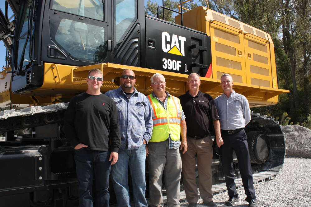 (L-R) are John, Dan and Gary Pink, all of Pink Grading; Jim Fischer, NMC CAT sales representative; and Dusty Weeter, director of branch operations, NMC CAT.