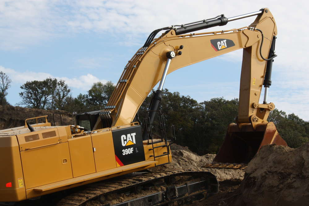 The operator prepares to put the new Cat 390F excavator into action.