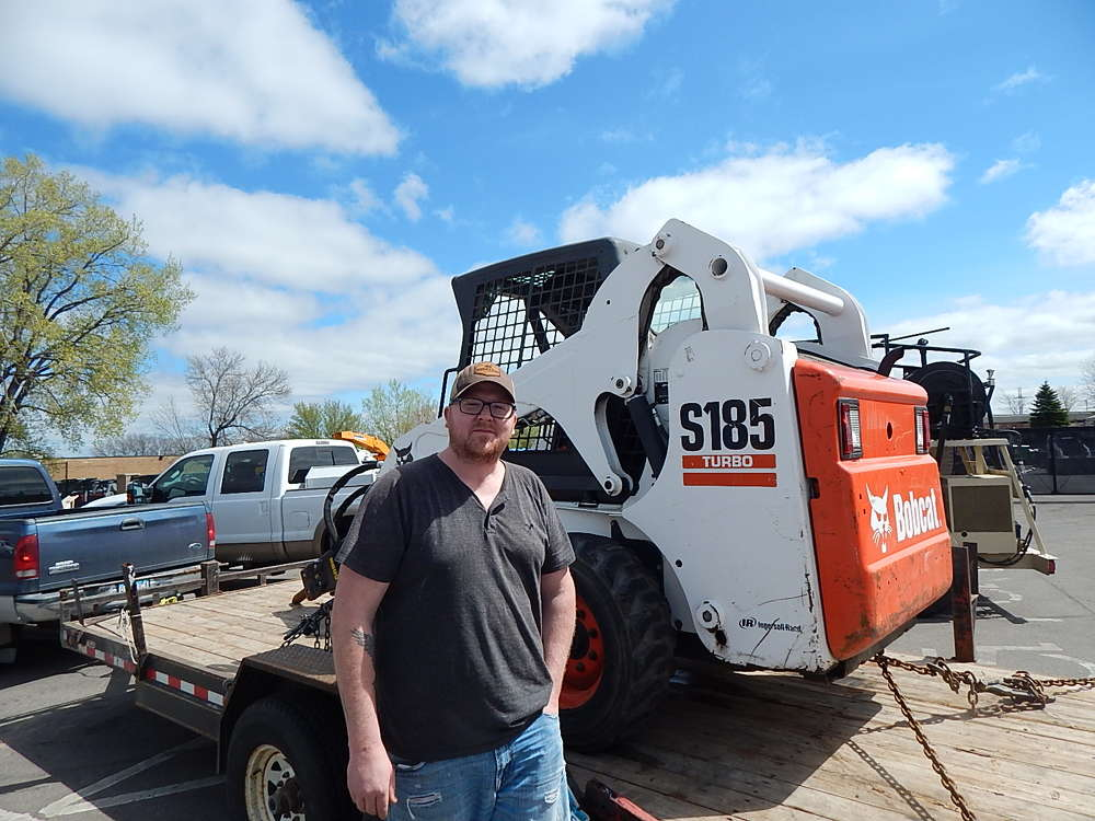 Mac Pautz of Pautz Concrete, Webster, Minn., and a longtime Tri-State Bobcat customer, gets the company's S185 serviced at the Burnsville open house.