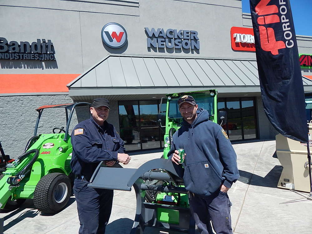 Dennis Bick (L) and Aaron Huntsman, grounds supervisors of the Minnesota Department of Corrections, Stillwater, Minn., look for equipment from Tri-State Bobcat in Hudson.