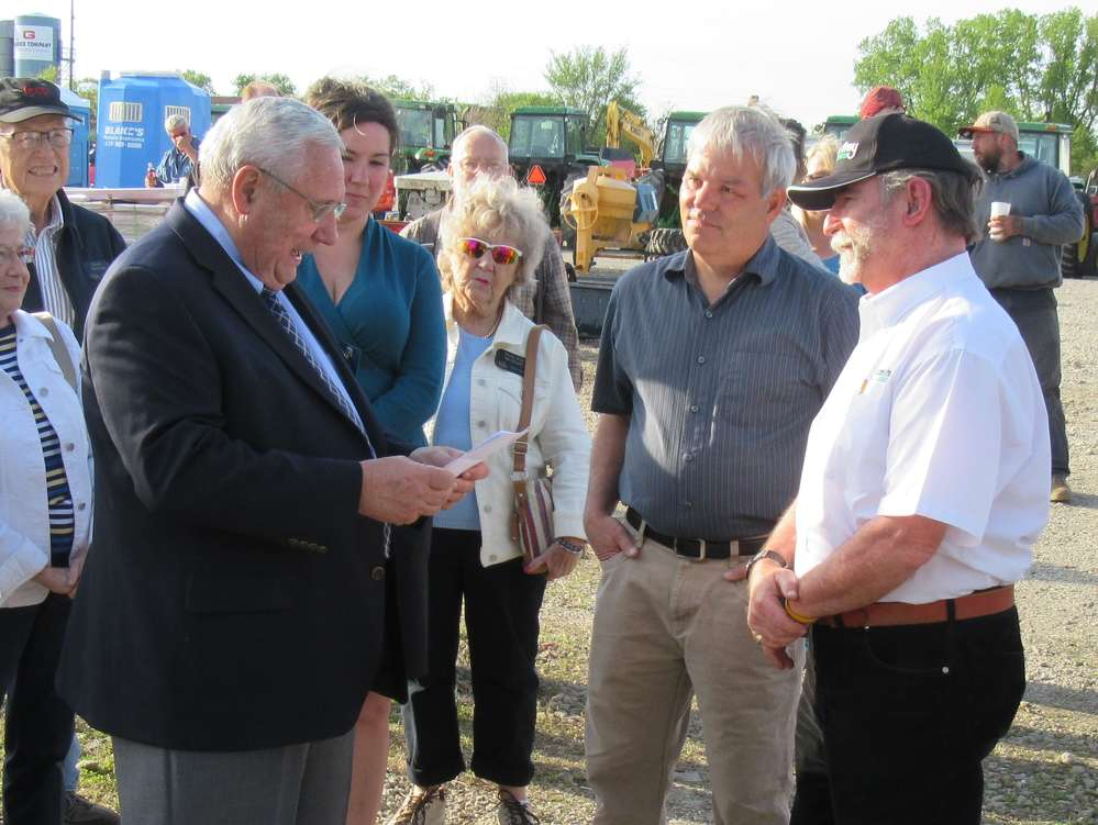 (L-R): Glen Stewart, Ashland mayor, greets David Allen of Allen Holdings of Ashland and Peter Clark and officially welcomes Yoder & Frey Auctioneers for its first Ashland, Ohio, auction.