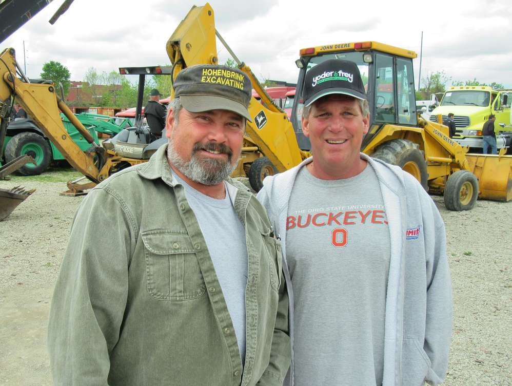 Rick Hohenbrink (L) of Hohenbrink Excavating, talks with Andy Heer of AWH Enterprises at the auction.
