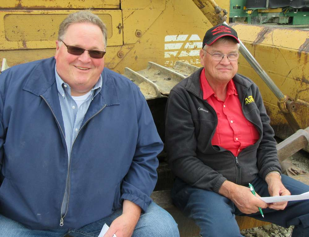 Ed Merritt (L) of Tractor Service & Supply Company and Gary Seals of Berne Reclamation, found a comfortable seat to watch the auction activities.