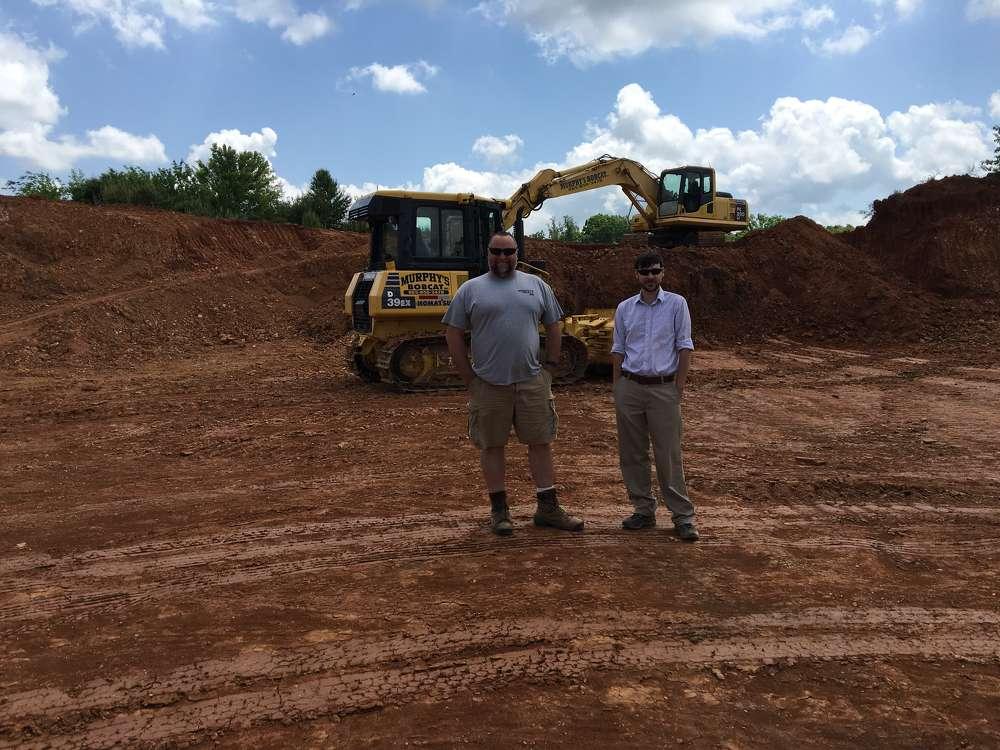 Rodney Murphy (L),  Murphy's Bobcat Inc., and Aaron Kiser, Power Equipment.