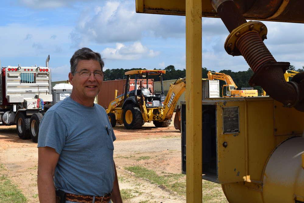 Joe Hill of Joe Hill Construction, Hartley, Del., inspects the equipment.