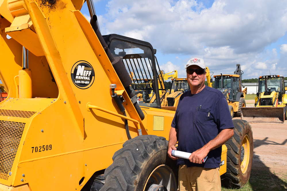 David Prins, Prins Bros Enterprise LLC, Polk City, Fla., looks for some equipment for his site prep business.