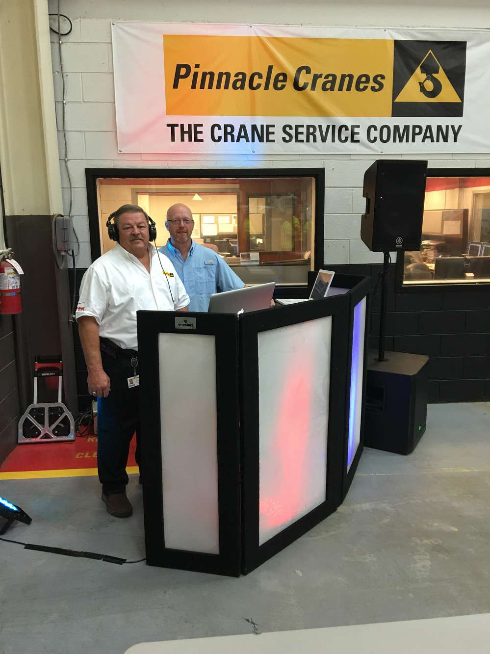 Ken Gamble (L), parts and service manager, begins playing Car Wash by Rose Royce while Scott Hill of Mobile Professional DJ & Lighting Services has the next song ready.