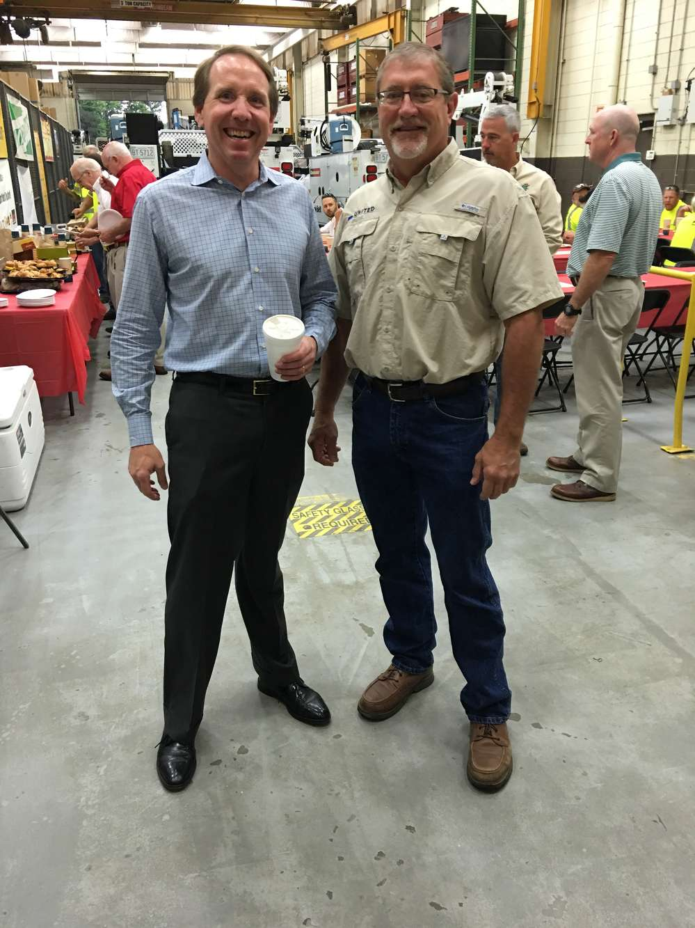 Ed Weisiger Jr. (L), president of Pinnacle Cranes and Carolina Tractor, welcomes Keith Ernandez of United Infrastructure Group in Great Falls, S.C.