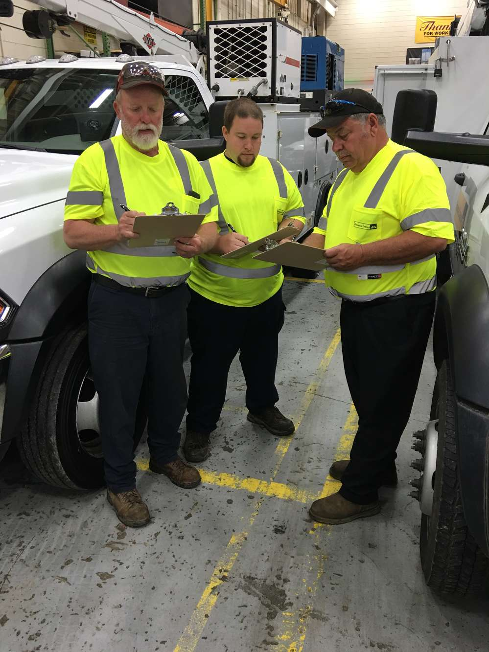 Boyce Helms, Wesley Beeker and Ray Mullis, service technicians, go over the different areas of consideration.