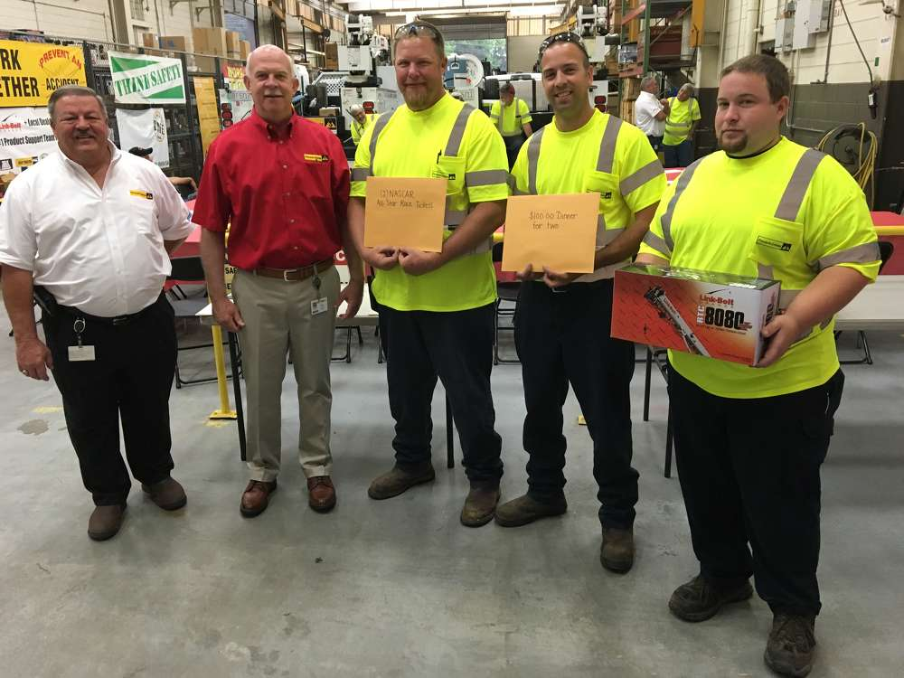 (L-R): Ken Gamble, parts and service manager, and Jim Mackinson, general manager of Pinnacle Cranes, congratulate the three winners Jeff Boesch, Cameron LaPham and Wesley Beeker.