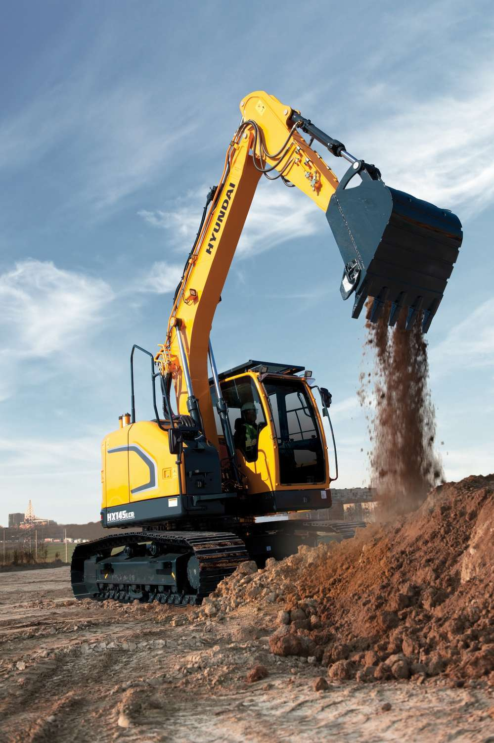 The 15.4 ton (14 t) HX145LCR compact radius excavator from Hyundai Construction Equipment Americas features new technologies that make the operating experience more comfortable, more ergonomic and more user-friendly.