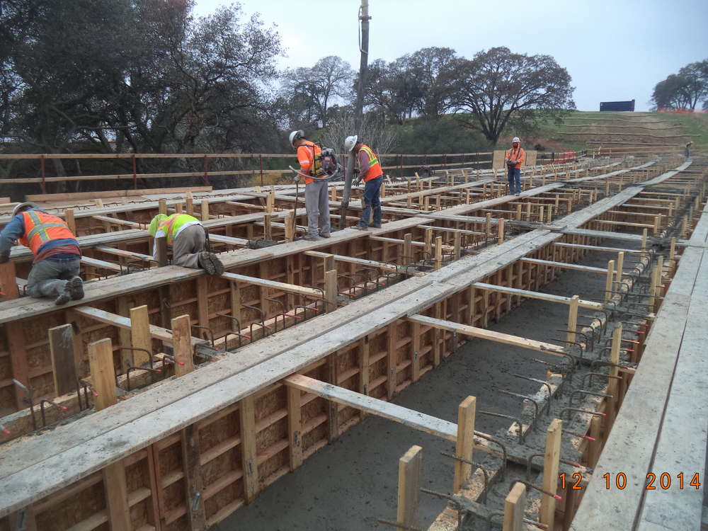 Myers & Sons Construction Company L.P. places concrete for the stem and soffit for the westbound off-ramp bridge.