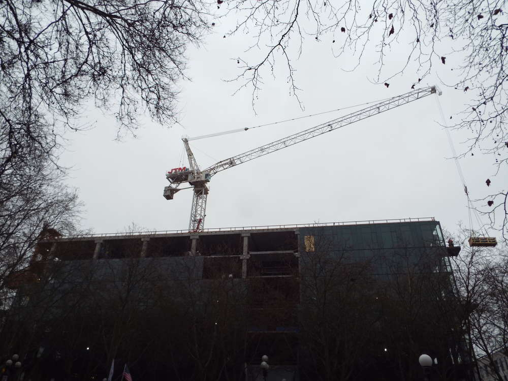 Andrea Watts photo Crane work had to be done without the benefit of the swing arm because of the nearby trees and buildings.