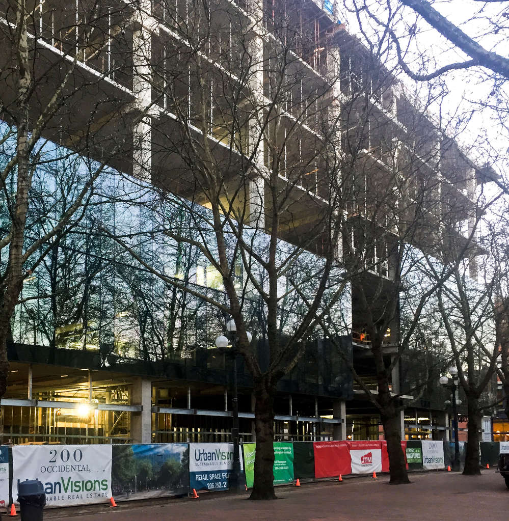 Mithun_200-Occidental-Construction –The Pioneer Square Preservation Board had final approval of the Mithun-designed building, and their concerns included how the coloration and the reflectivity of the glass complemented the park and whether the overall building would fit in with the rest of the neighborhood.