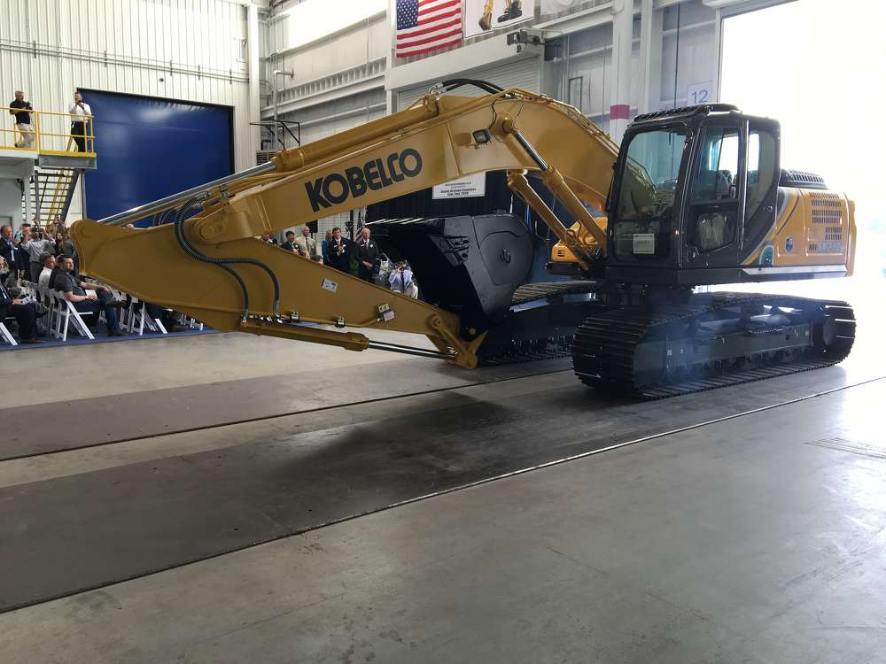 The very first Kobelco SK210LC makes its grand entrance.