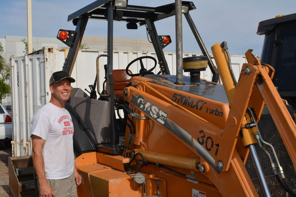 This Case 570 loader drew interest from several auction-goers, including potential bidder Derek Elkins of Phoenix, Ariz.