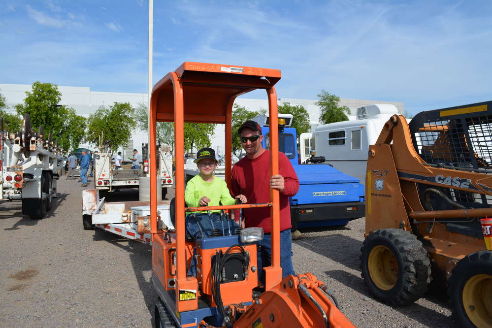 Ryan MacLiver (R) would be happy for his son, Dillon, to follow in his footsteps as an equipment operator. MacLiver operates cranes for Stanford Crane in Arizona.