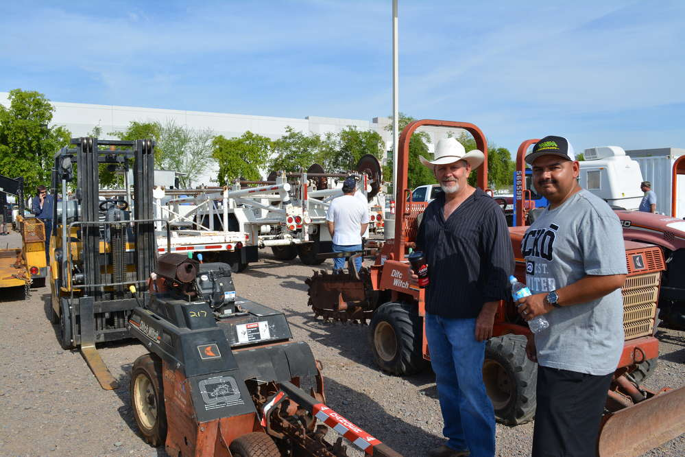 Longtime friends, Shane Dikoff (L), president of Shane's Grading and Paving, Phoenix, Ariz., and Ricky Dehoyoz, president of GW Asphalt, Phoenix, Ariz., paused to look at the Ditch Witch 1820 trencher.