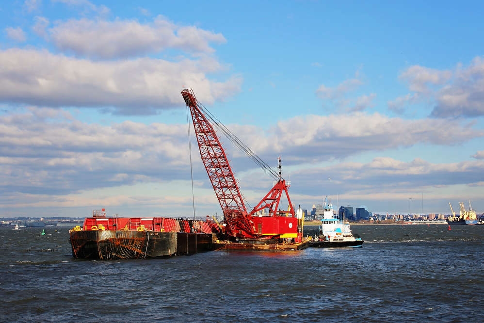 USACE Baltimore District photo. Also in coordination with the state of Maryland, the roughly 550,000 cu. yds. (420,505 cu m) of material dredged from channels above the Key Bridge will be placed at Cox Creek Dredged Material Containment Facility.
