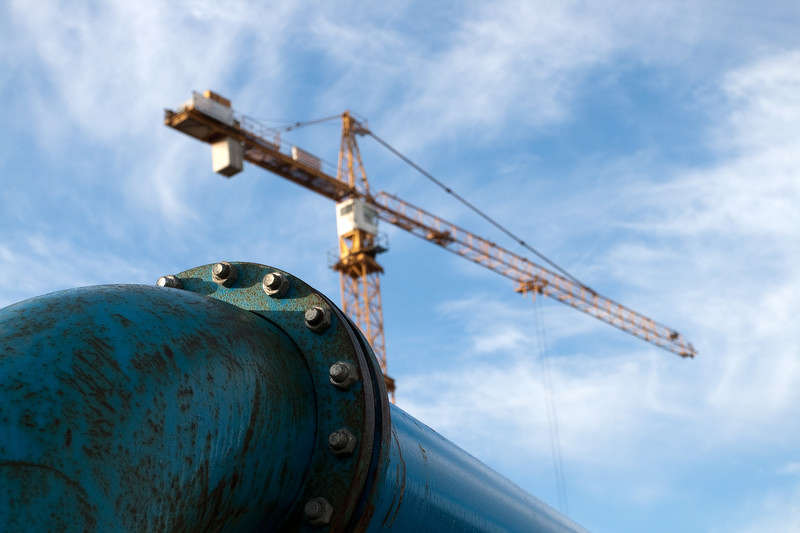 Two lawsuits aimed at stopping an oil pipeline company from exercising eminent domain to obtain private land along the pipeline route were dismissed Monday.