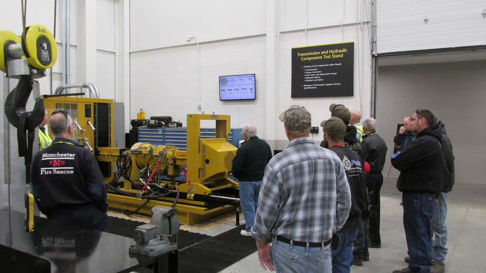 Several hundred customers toured the facility; here visitors take in the hydraulic component test stand.